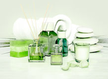 Spa and wellness setting with natural soap, candle and towel on. Light green background Royalty Free Stock Photography