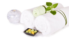 Spa and wellness setting with natural soap, candle and towels Royalty Free Stock Photo