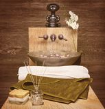 Spa and wellness setting with natural soap, candles and towel. C Stock Photo