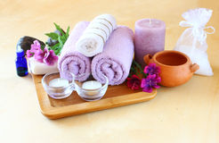 Spa and wellness setting with natural soap, candles and towel. natural wooden background Royalty Free Stock Photography