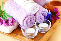 Spa and wellness setting with natural soap, candles and towel. natural wooden background Stock Image