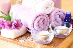 Spa and wellness setting with natural soap, candles and towel. natural wooden background Stock Images