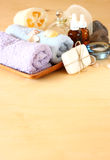 Spa and wellness setting with natural soap, candles and towel. natural wooden background Royalty Free Stock Images
