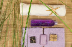 Spa and Wellness setting with natural soap, stones towel Bamboo.  Royalty Free Stock Photo
