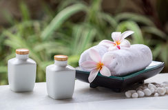 Spa and wellness setting with natural soap, stones and towel on the green background . Stock Photo