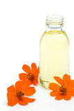Spa and wellness setting with oil essence and flowers Stock Photo