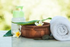 Spa or wellness setting outdoors with tropical flowers stock images