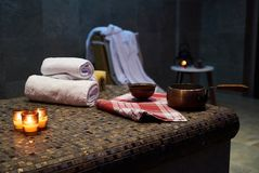 Spa and wellness setting with Rolled spa towels. Candles and aroma oil in a sauna room stock images