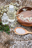 Spa and wellness setting with sea salt, oil essence, flowers and Stock Photos