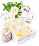 Spa and wellness setting with soap, bath salts and towels Stock Images