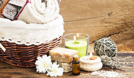 Spa and Wellness Setting with Towels,Candle, Natural Soap and Es Stock Photos