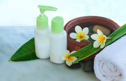 Spa or wellness setting with tropical flowers, bowl of water royalty free stock photos