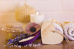 Spa and wellness setting with white towels , sponge, candle, lav Royalty Free Stock Photo