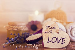 Spa and wellness setting with white towels , sponge, candle, lav Royalty Free Stock Images