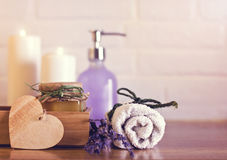 Spa and wellness setting with white towels , sponge, candle, lav Stock Photos