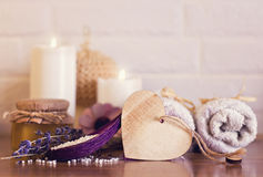 Spa and wellness setting with white towels , sponge, candle, lav Stock Photo