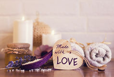 Spa and wellness setting with white towels , sponge, candle, lav Royalty Free Stock Photography