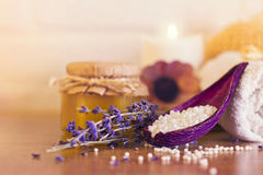 Spa and wellness setting with white towels , sponge, candle, lav Stock Image
