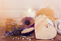 Spa and wellness setting with white towels , sponge, candle, lav Royalty Free Stock Photos