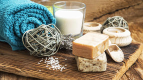 Spa and Wellness Setting on Wooden Background with Natural Homem. Calm Spa Scene, Wellness Setting with Homemade Soaps,Candles and Lavander Bouquet on Wooden Stock Photography