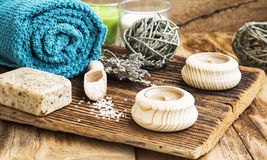 Spa and Wellness Setting on Wooden Background with Towel, Candle Stock Images