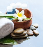 Spa or wellness small bottles with oil for massage treatment. And bowl of water, towel stock photo