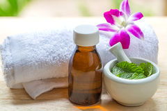 Spa and wellness and towels on wooden background. Royalty Free Stock Images