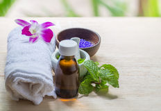 Spa and wellness and towels on wooden background. Royalty Free Stock Image