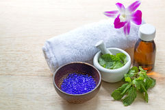 Spa and wellness and towels on wooden background. Royalty Free Stock Photography