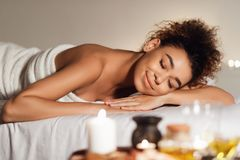 Spa and wellness. Woman relaxing with aroma composition. Nearby stock photography