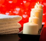 Spa, white candles and towel stacked on wood table valentine day concept Royalty Free Stock Image