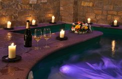 Spa with wine and candles Royalty Free Stock Images