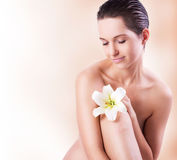 Spa woman. Portrait of spa woman with flower Royalty Free Stock Photography
