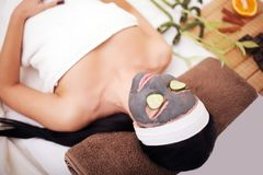 Spa Woman applying Facial cleansing Mask. Beauty Treatments. Clay mask Stock Photos