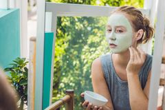 Spa Woman applying Facial green clay Mask. Beauty Treatments. Cl Royalty Free Stock Image