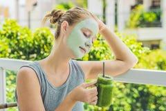 Spa Woman applying Facial green clay Mask. Beauty Treatments. Fr Royalty Free Stock Photography