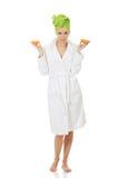 Spa woman in bathrobe holding orange. Stock Photo