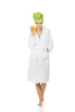 Spa woman in bathrobe holding orange. Stock Photography