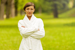 Spa woman in bathrobe in nature. Royalty Free Stock Photos