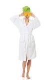 Spa woman in bathrobe with orange. Royalty Free Stock Photo
