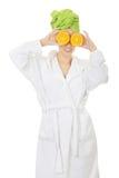 Spa woman in bathrobe with orange. Royalty Free Stock Photos