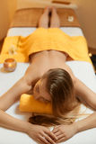 Spa Woman. Beautiful Blonde Relaxing in Spa Salon Stock Photography