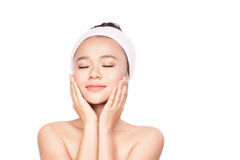 Spa Woman. Beautiful Girl After Bath Touching Her Face. Perfect Skin. Skincare. Young Skin. Isolated on white Stock Photos