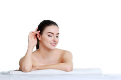 Spa Woman. Beautiful Girl. Perfect Skin. Skincare. Wellness adve. Young spa woman touching her face after beauty treatment Stock Photos