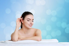 Spa Woman. Beautiful Girl. Perfect Skin. Skincare. Wellness adve. Young spa woman touching her face after beauty treatment Stock Image