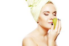 Spa Woman. Beautiful girl after taking bath. Spa Woman concept. Beautiful Girl With Ginger Hair After Bath Touching Smelling Green Soap. Perfect Skin. Skincare stock photos
