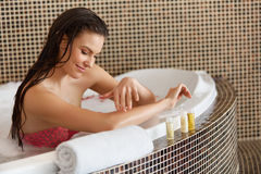 Spa Woman. Beautiful Woman in Bath Cares About Her Hands. Body c Stock Image