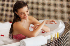 Spa Woman. Beautiful Woman in Bath Cares About Her Hands. Body c Royalty Free Stock Photography
