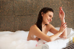 Spa Woman. Beautiful Woman in Bath Cares About Her Hands. Body c Royalty Free Stock Images