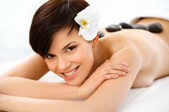 Spa Woman. Beautiful Woman Getting Hot Stones Massage. In Spa Salon. High quality image stock photography